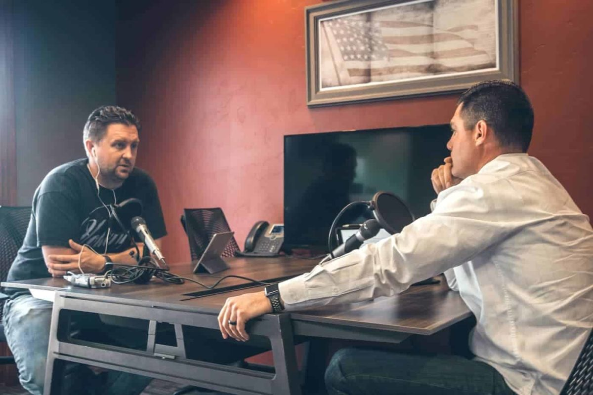 Two men recording a podcast