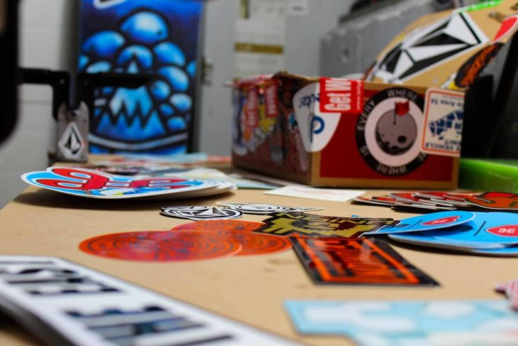 Bunch of Stickers Laying on a Desk