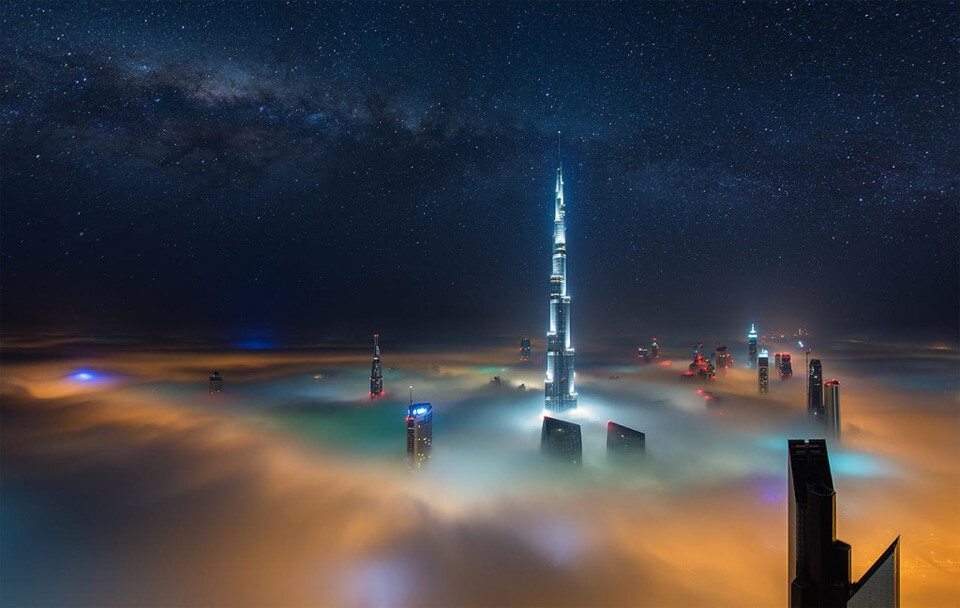 Dubai At Night Above The Clouds by Daniel Cheong
