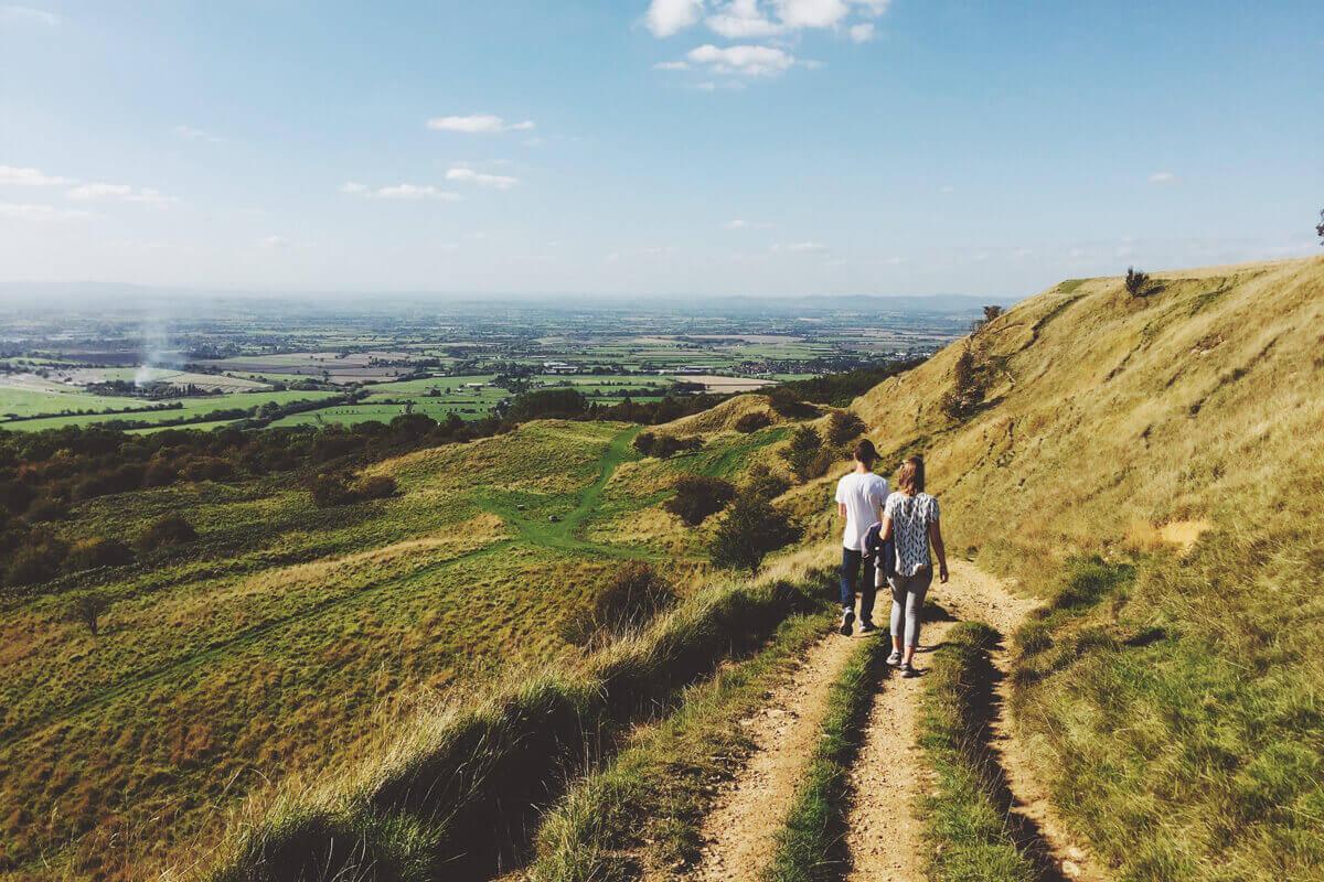Couple Hiking Down a Mountain