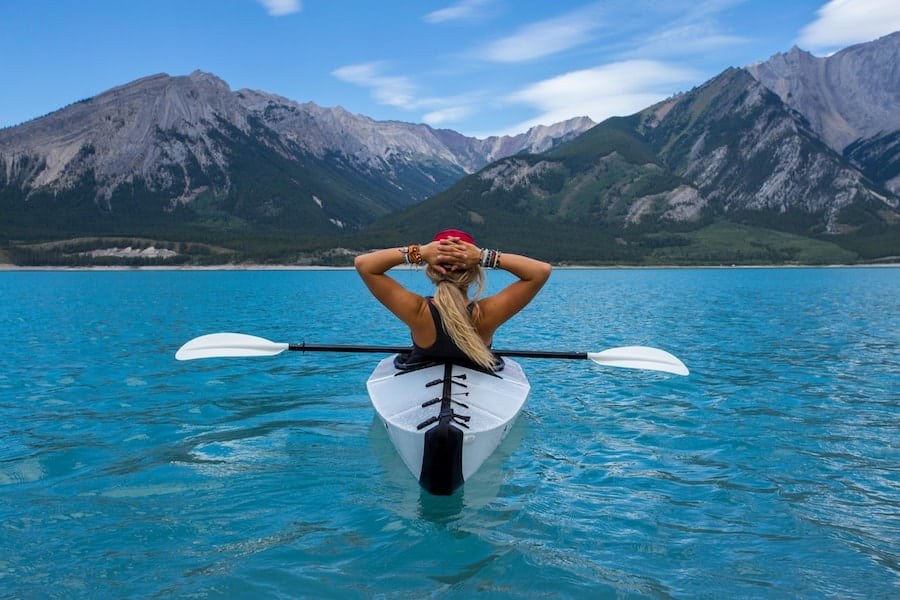 Woman resting after kayaking to the middle of the lake