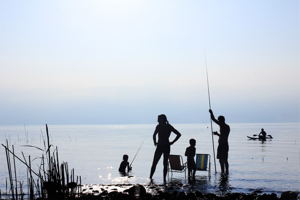 Family fishing together at the lake