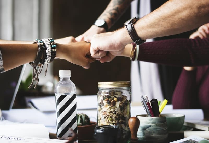 colleagues-cooperation-fist-bump-fists