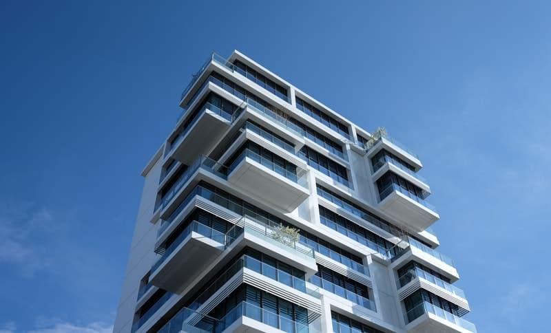 Beautiful modern apartment building against a blue sky