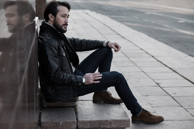 black leather jacket man sitting-in-city