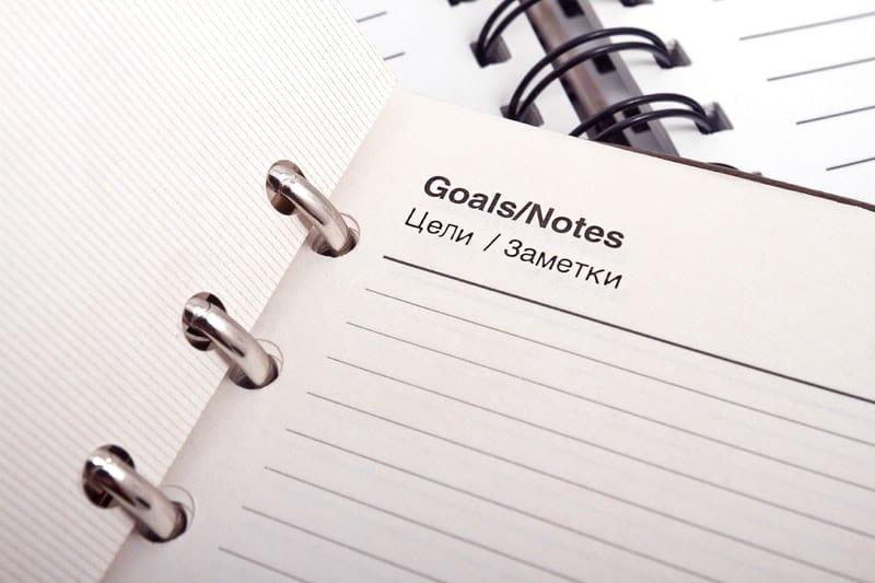 Close up of goals notebook