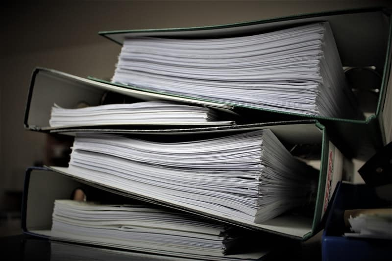 batches of paperwork stacked on a desk