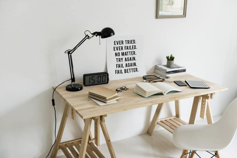 modern wooden home desk with books on top