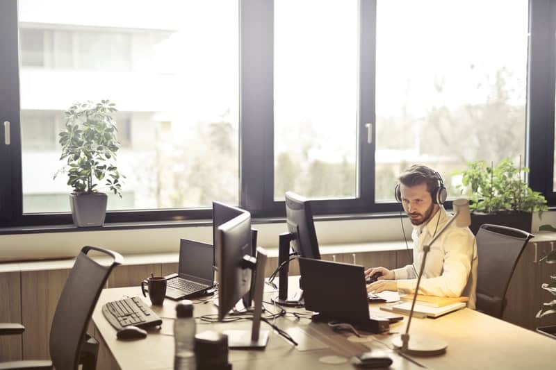 man with headphones using computer