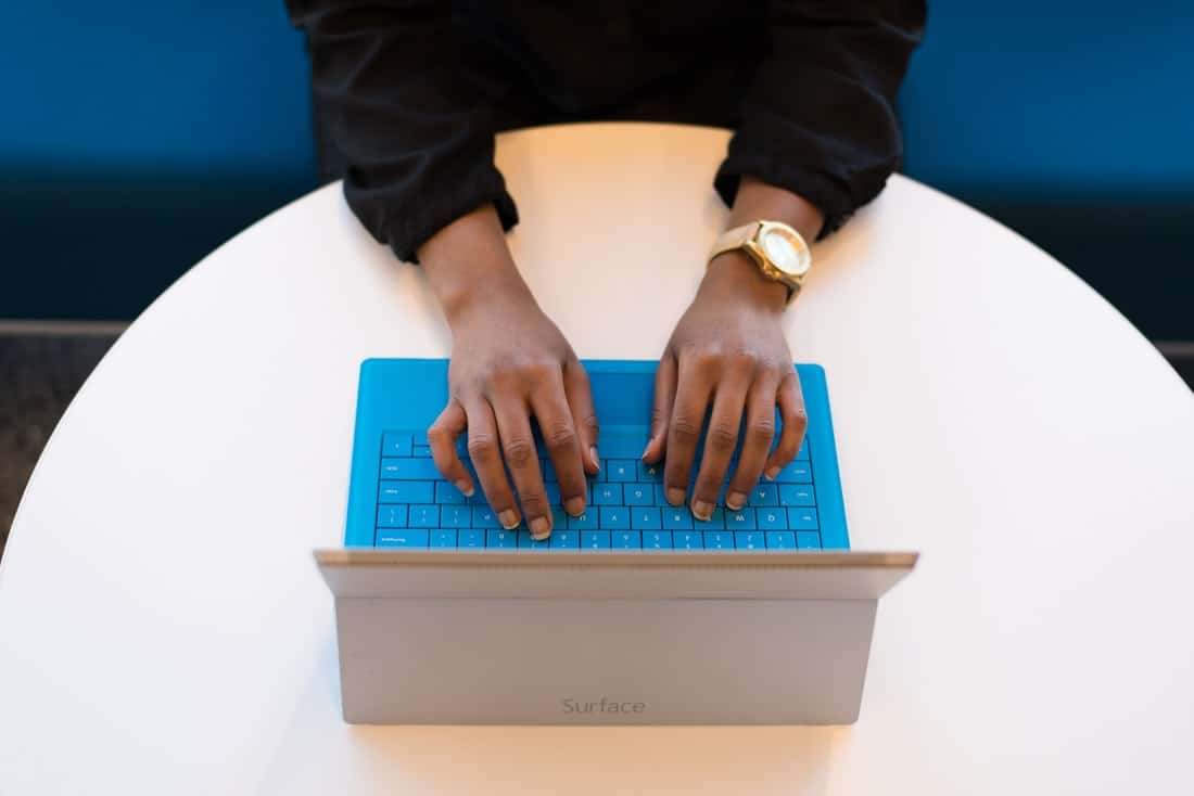 person typing on a microsoft surface