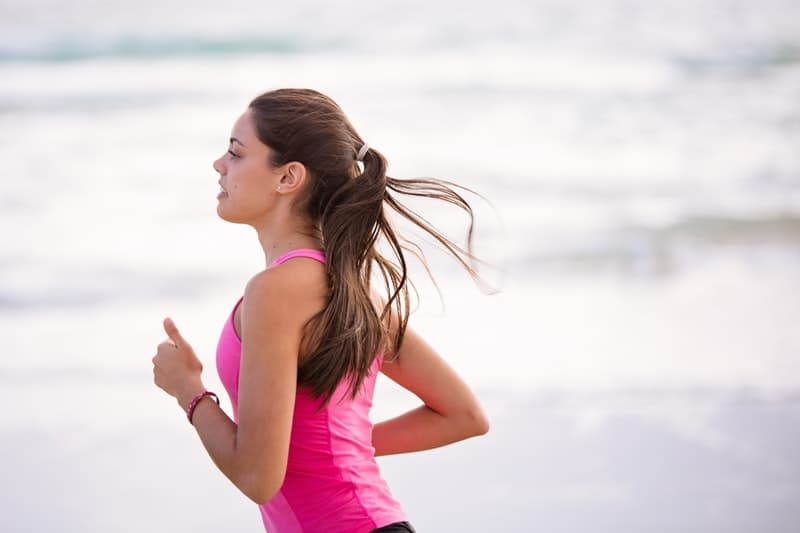 woman in pink shirt jogging