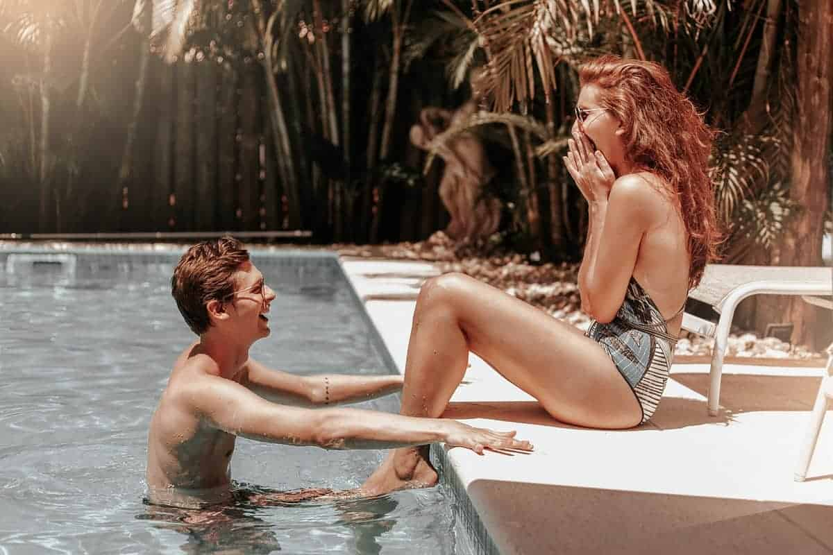 Couple swimming at the pool during a hot summer day