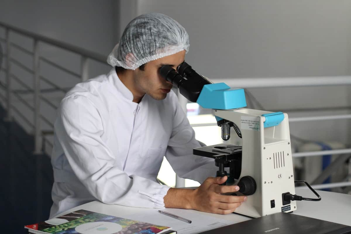 Man performing a DNA test inside his Laboratory