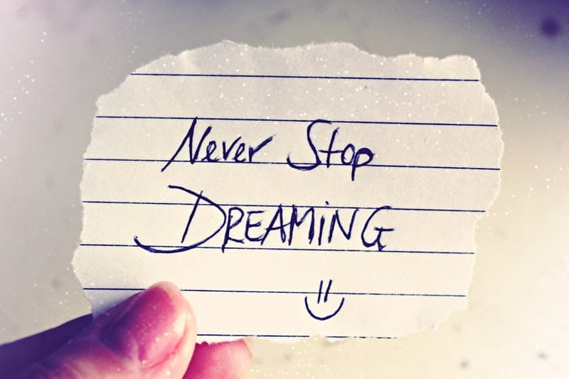 Never stop dreaming writting on a small note