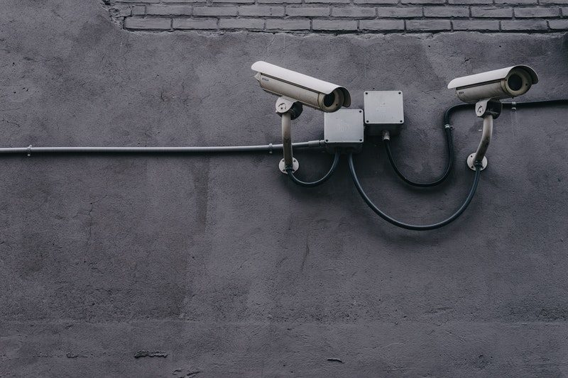 Security Cameras Against a Grey Background