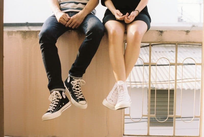 boy and girl sitting together on a rooftop