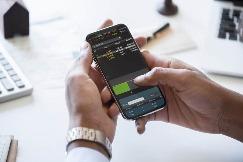 man using a smartphone to check stock quotes