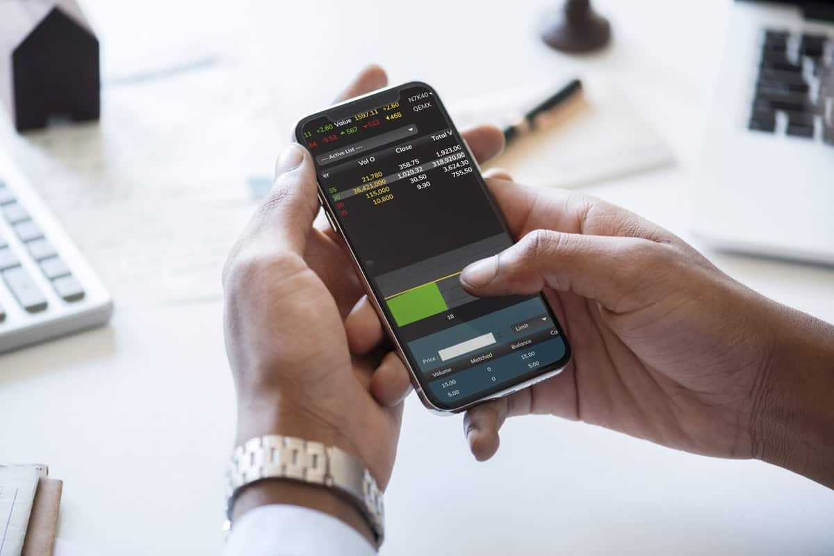 person doing daily trading from his smartphone