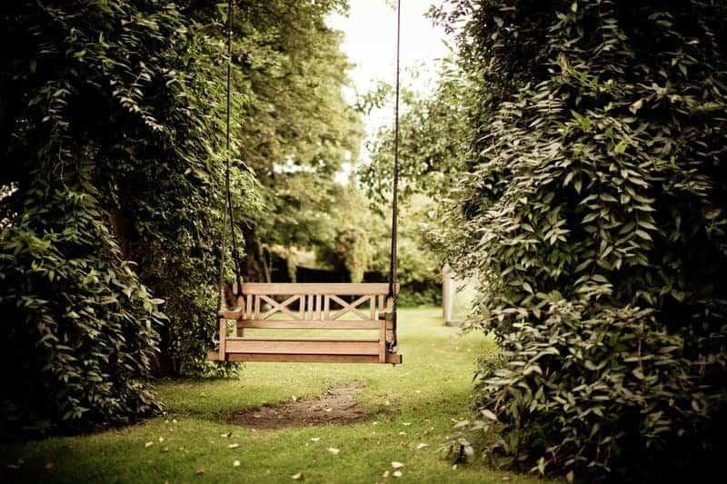 wooden swing inside a garden
