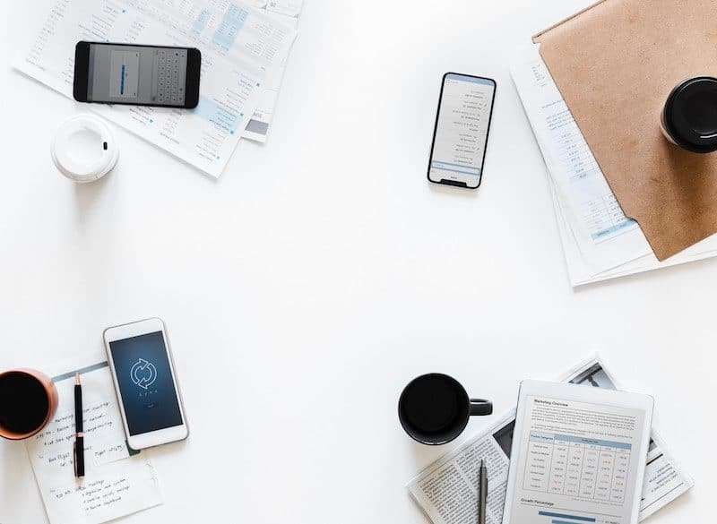 Business smartphones laying on a white desk