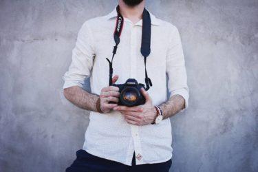 Man Wearing White Long Sleeves Holding Black Canon Dslr Camera
