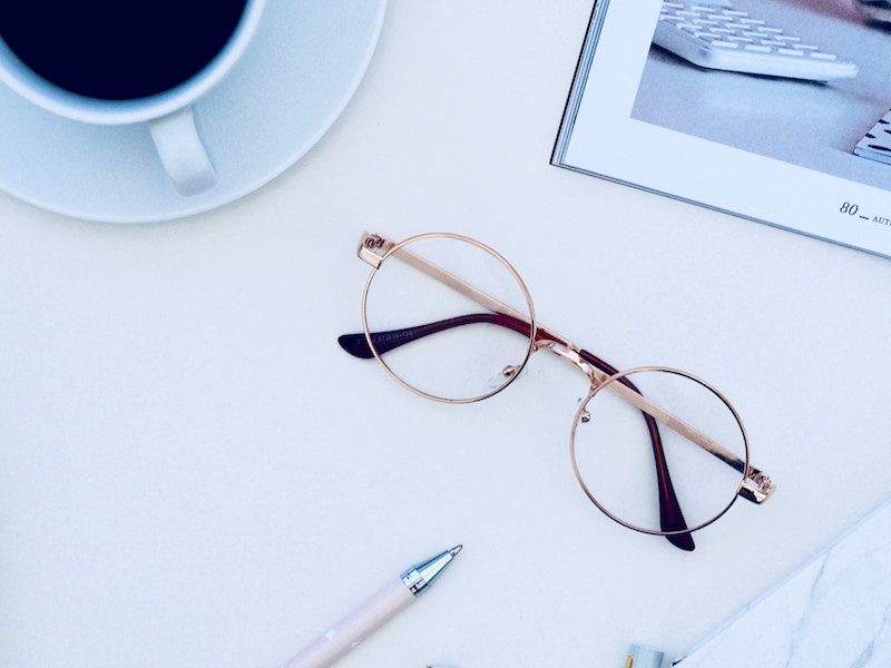 Reading Glasses on a White Desk