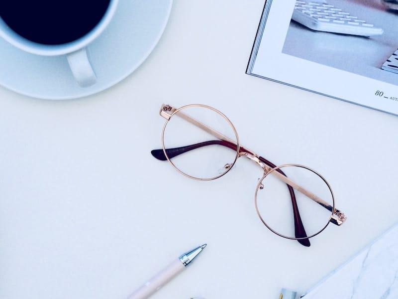 Reading Glasses on a White Desk