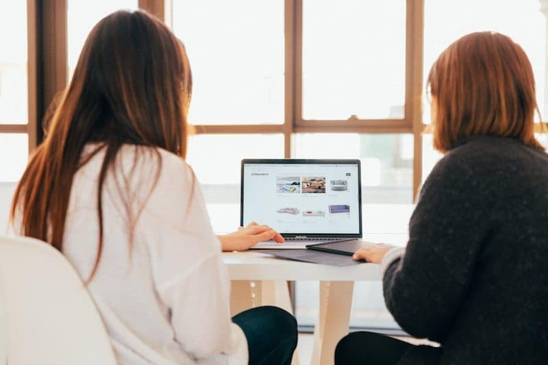 Two Women Coming up with search queries