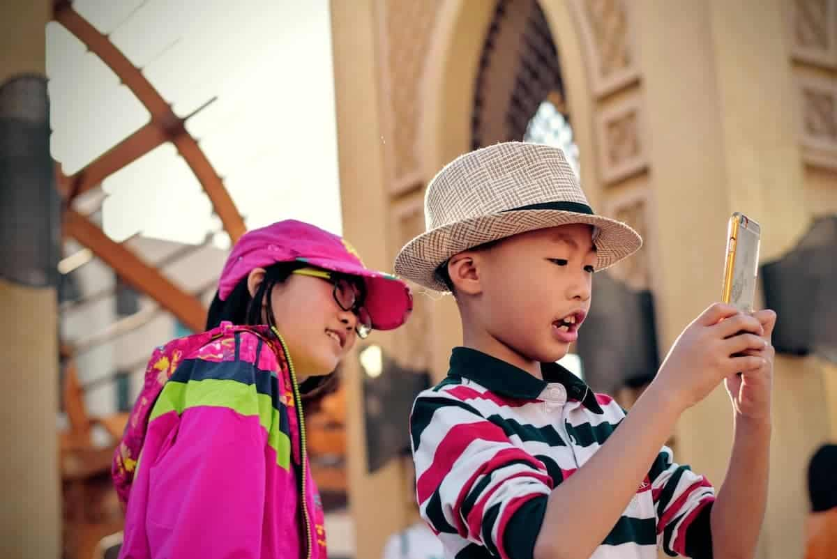 Two kids playing with a smartphone