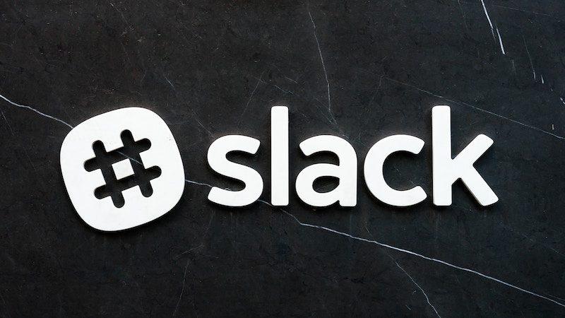 slack logo against a black wall