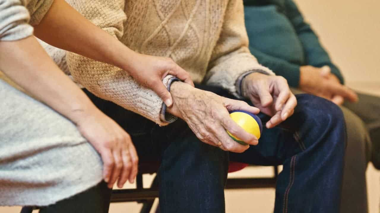 adult holding a stress ball