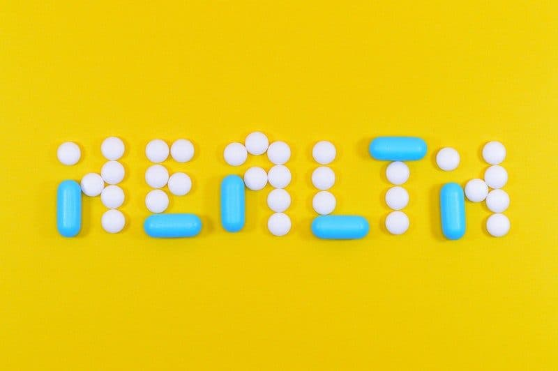 health spelled out with prescription pills