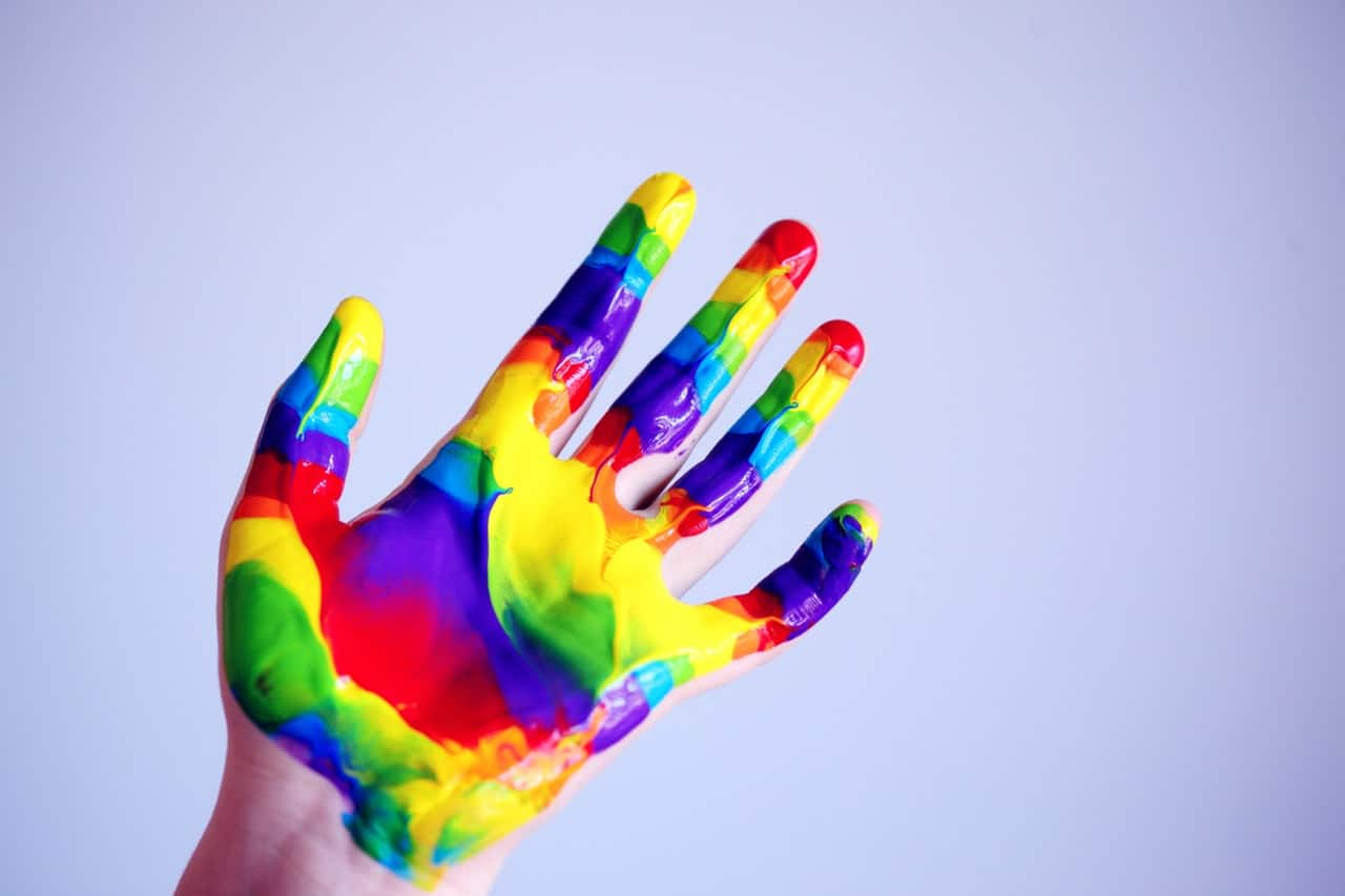 persons hand in paint