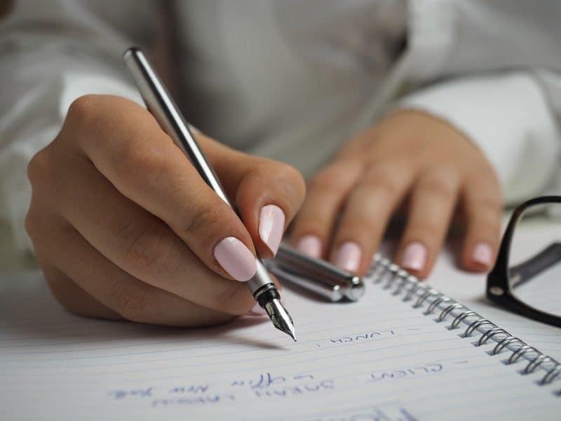 woman writing a to-do list