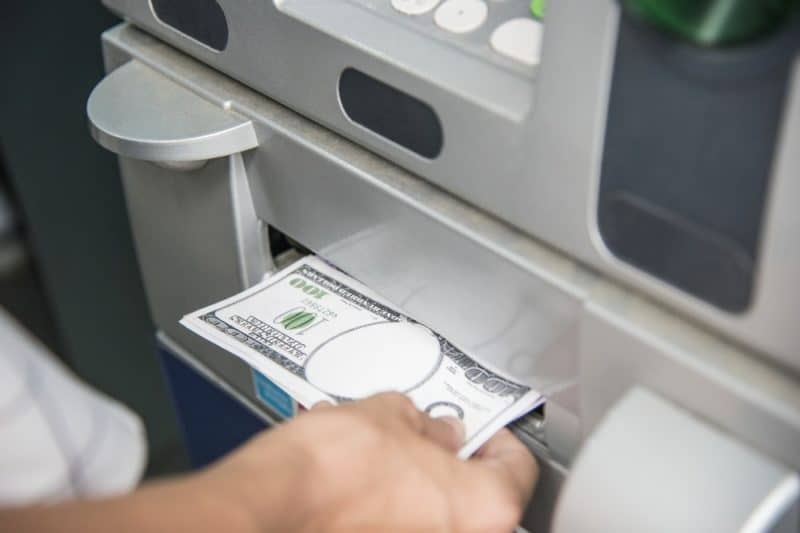 person pulling money out from an ATM