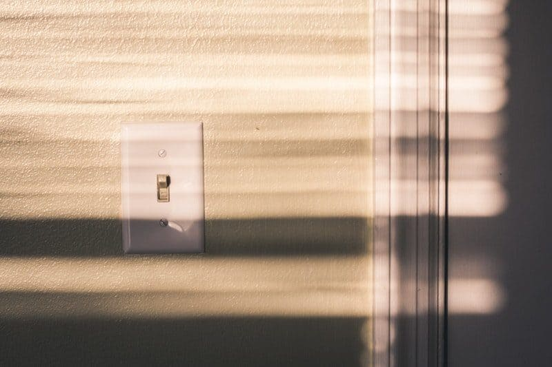white wall light switch