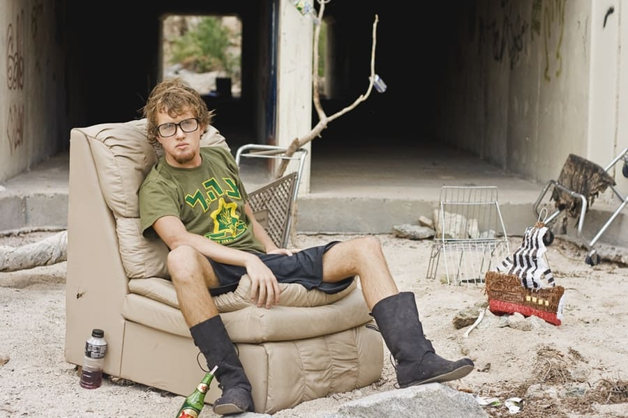 College Dropout Sitting on a Sofa Chair Outside