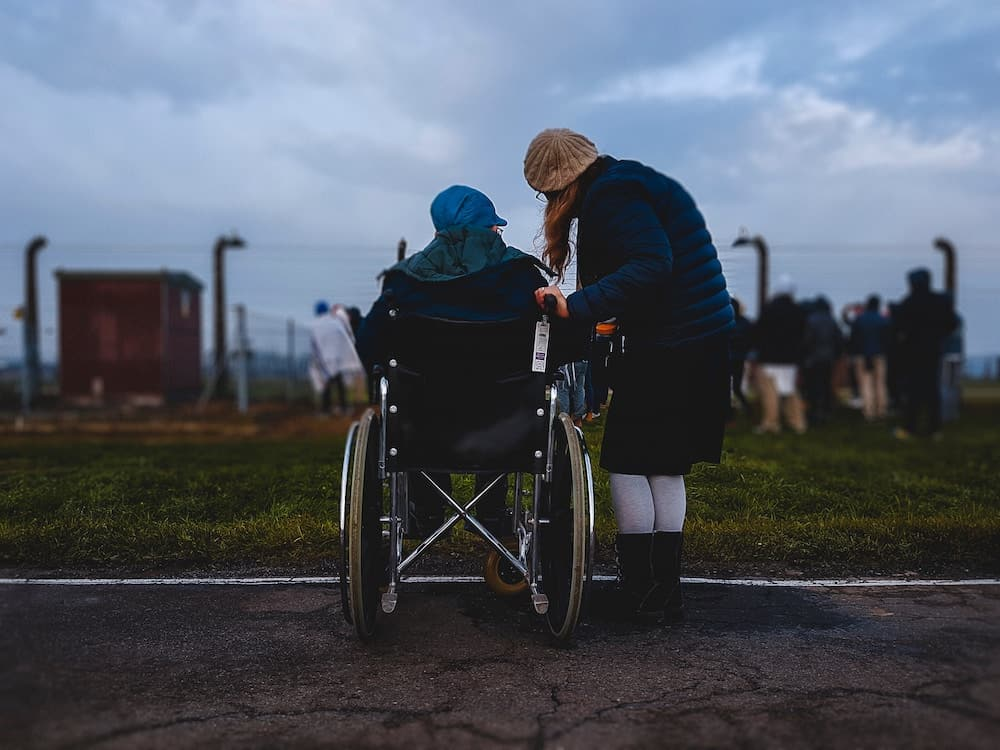 Daughter with her mother in a wheelchair