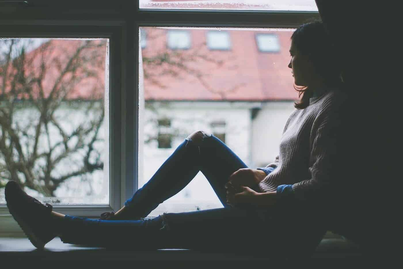 Depressed Girl Looking Outside The Window