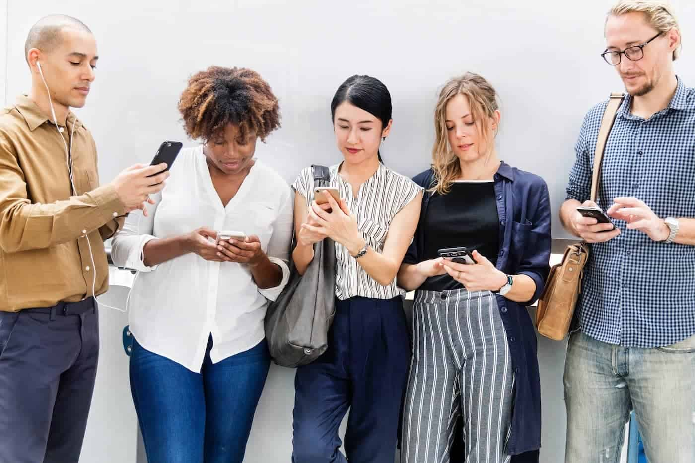 Group of people using their cell phones