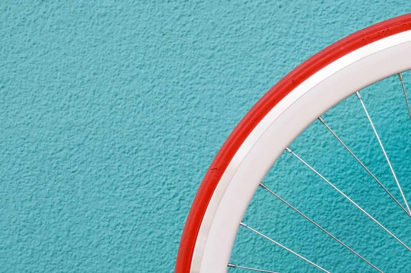 Minimal bike tire against a blue background