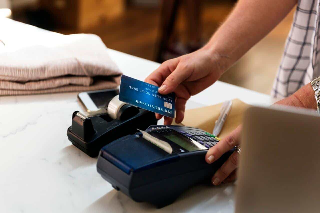 Person Holding Card and Terminal