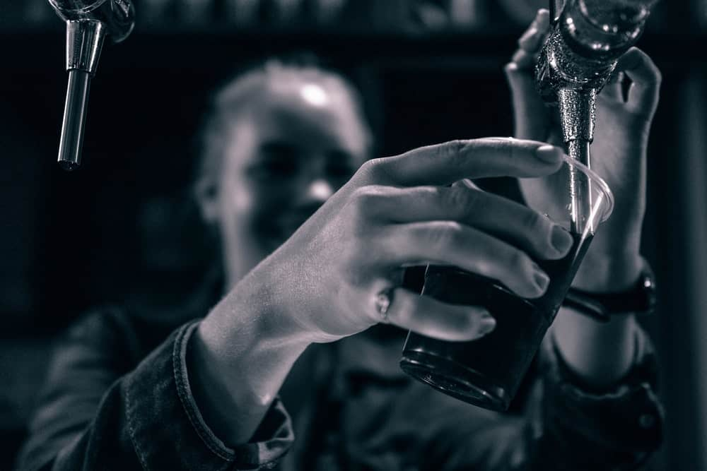 Woman pouring alcohol
