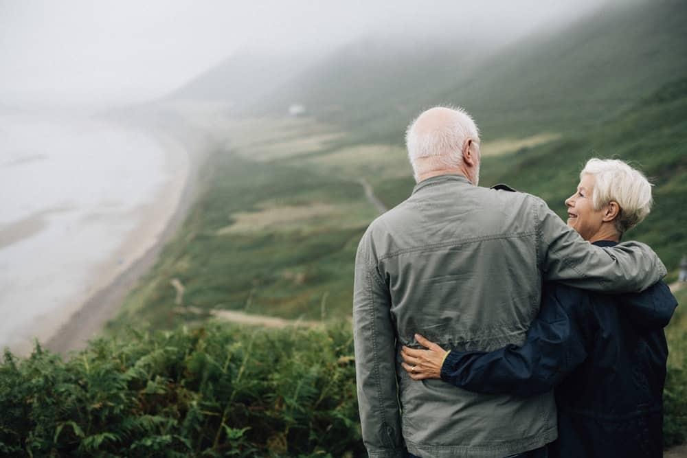 Elderly Couple overlooking a beautiful landscape