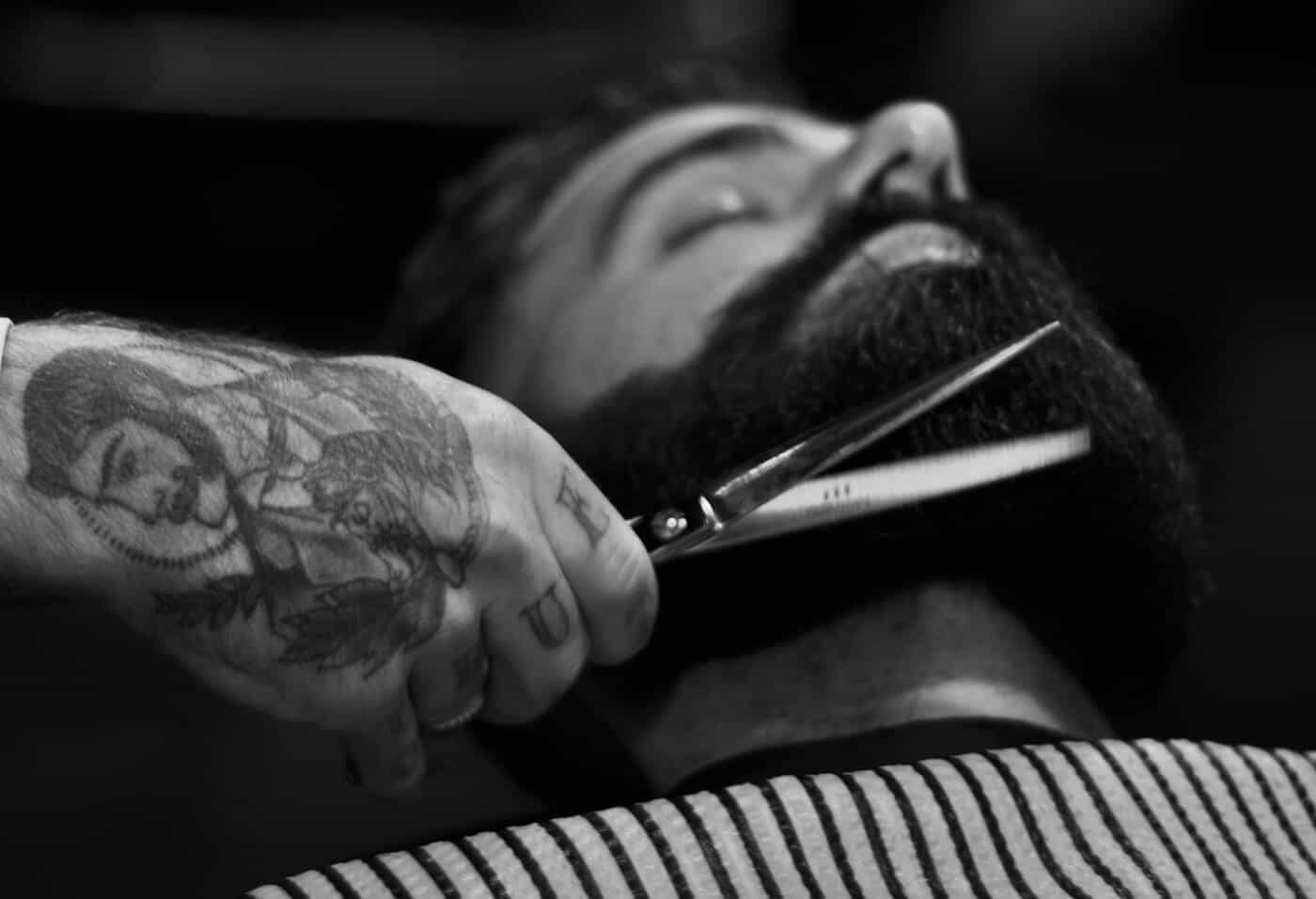 Man Getting His Beard Shaved