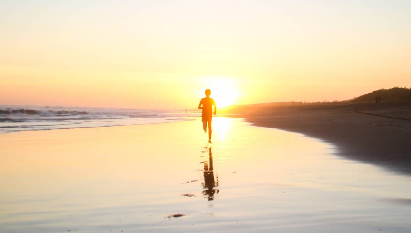 Man Running in The Morning on The Beach