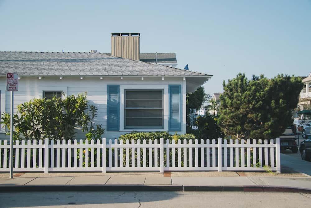 White fence around a modern home