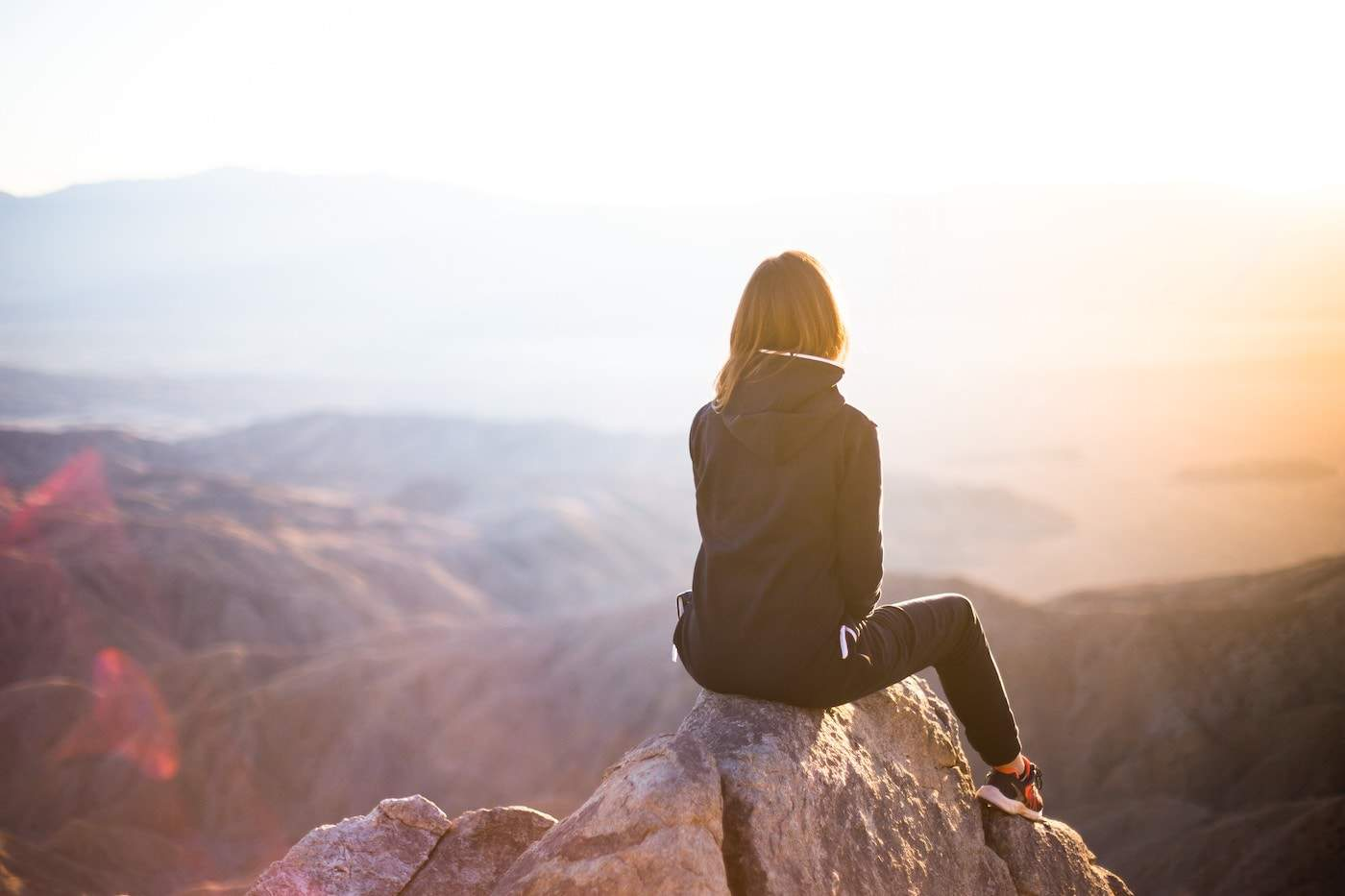 Woman looking out onto the mountains