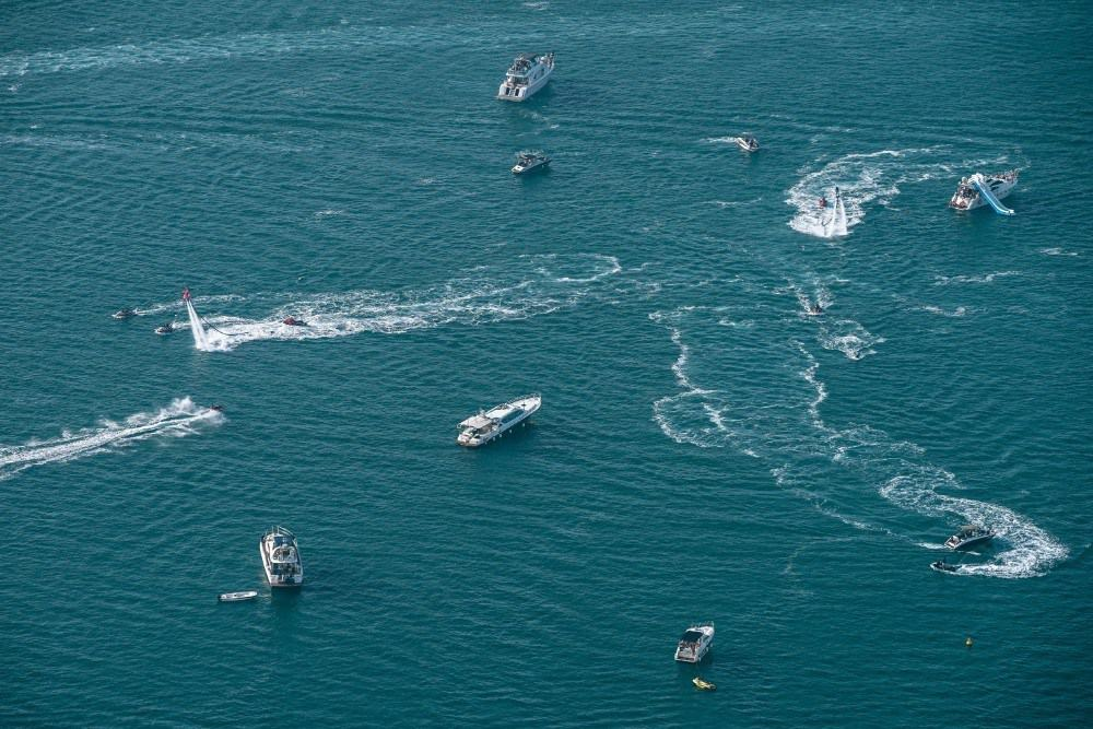 Different Boats and Jet Skis in the Water