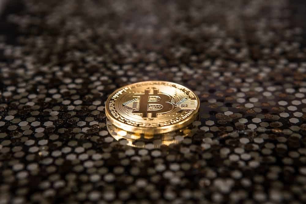 goldcolored Bitcoin coin on ground